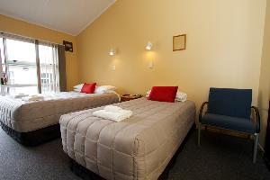 Queen bed & single bed plus seating area