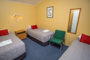 3 single beds in second bedroom