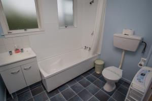 Bathroom with shower over bath & washing machine