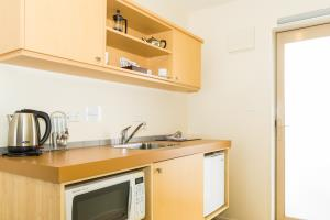 Kitchenette: microwave, kettle, fridge, toaster