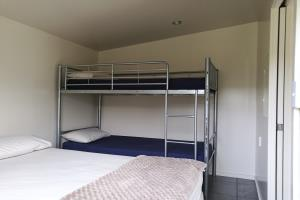Bedroom with double bed and set of single bunks