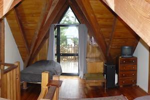 Top Shelf log cabin mezzanine with 3 singles