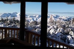 Sandy Heights log cabin winter view